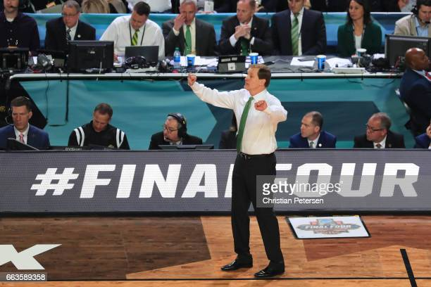 Head coach Dana Altman of the Oregon Ducks instructs his team against the North Carolina Tar Heels during the 2017 NCAA Men's Final Four Semifinal at...