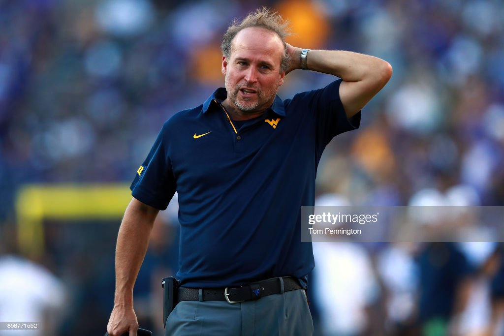 Head coach Dana Holgorsen of the West Virginia Mountaineers reacts to a play against the TCU Horned Frogs in the fourth quarter at Amon G. Carter Stadium on October 7, 2017 in Fort Worth, Texas.