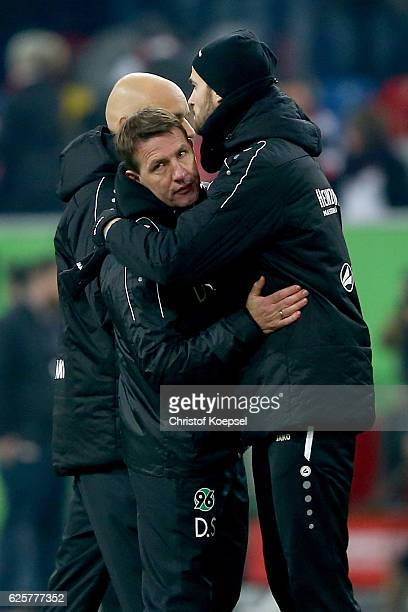 Head coach Daniel Stendel of Hannover gets embraced after the Second Bundesliga match between Fortuna Duesseldorf and Hannover 96 at EspritArena on...