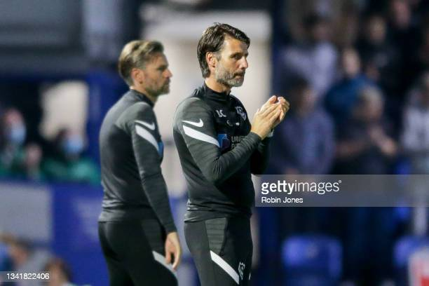 Head Coach Danny Cowley of Portsmouth FC claps on the 10 minute mark in memory of Sophie Fairall, a young cancer sufferer who died earlier in the...