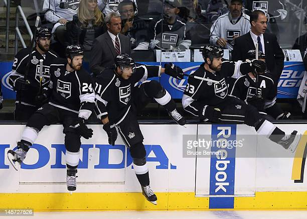 Head Coach Darryl Sutter and assistant coach John Stevens look on as Kings players change on the fly in the first period of Game Three of the 2012...