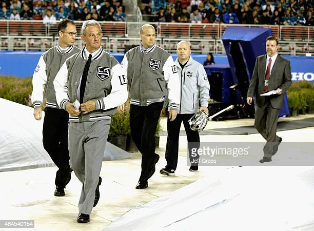 Head coach Darryl Sutter and assistant coach John Stevens of the Los Angeles Kings walk on to the field before the start of the 2015 Coors Light NHL...