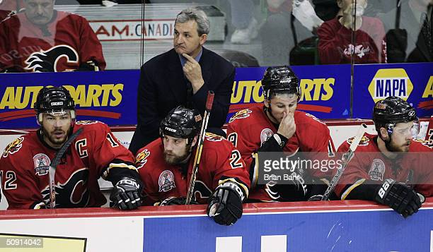 Head coach Darryl Sutter and the Calgary Flames bench look on during the third period against the Tampa Bay Lightning in game four of the NHL Stanley...