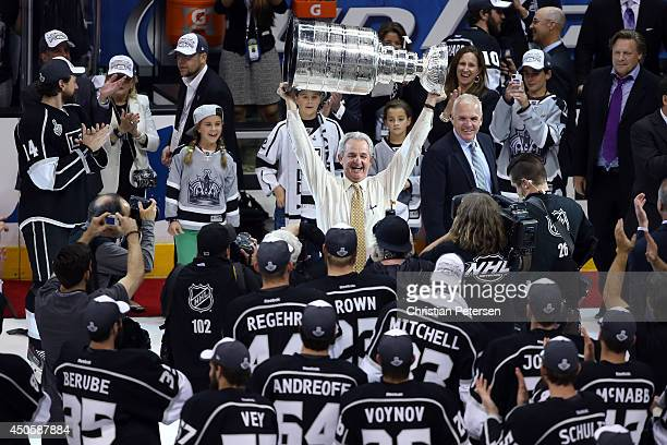 Head coach Darryl Sutter of the Los Angeles Kings celebrates with the Stanley Cup after the Kings 32 double overtime victory against the New York...
