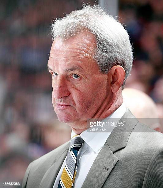 Head coach Darryl Sutter of the Los Angeles Kings looks on from the bench during their NHL game against the Vancouver Canucks at Rogers Arena April 5...