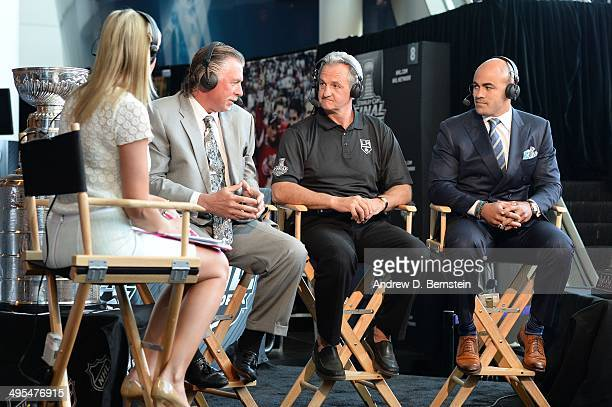 Head coach Darryl Sutter of the Los Angeles Kings participates in an interview with the NHL Network during the 2014 NHL Stanley Cup Final Media Day...