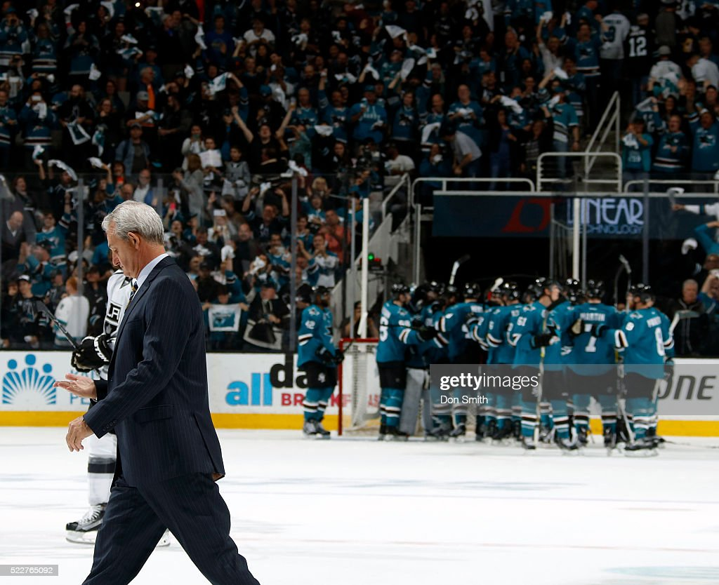 Head Coach Darryl Sutter of the Los Angeles Kings walks off as the San Jose Sharks celebrate on the ice after the San Jose Sharks victory during the Western Conference First Round during the 2016 NHL Stanley Cup Playoffs at the SAP Center at San Jose on April 20, 2016 in San Jose, California.