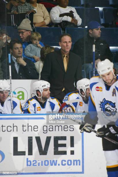 Head coach Dave Baseggio of the Bridgeport Sound Tigers looks on against the Hartford Wolf Pack at the Arena at Harbor Yard on December 4 2005 in...