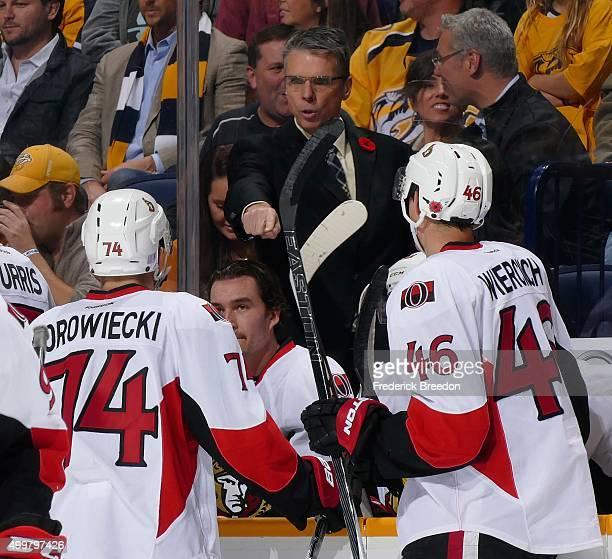 Head coach Dave Cameron of the Ottawa Senators coaches against the Nashville Predators during the first period at Bridgestone Arena on November 10...