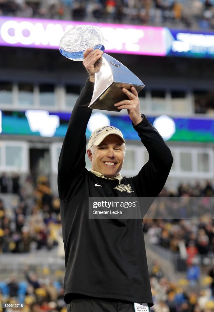 Head coach Dave Clawson of the Wake Forest Demon Deacons celebrates with the trophy after defeating the Texas A&M Aggies 55-52 after the Belk Bowl at Bank of America Stadium on December 29, 2017 in Charlotte, North Carolina.