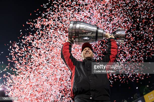 Head coach Dave Dickenson of the Calgary Stampeders hoists the Grey Cup after defeating the Ottawa Redblacks during the second half of the Grey Cup...