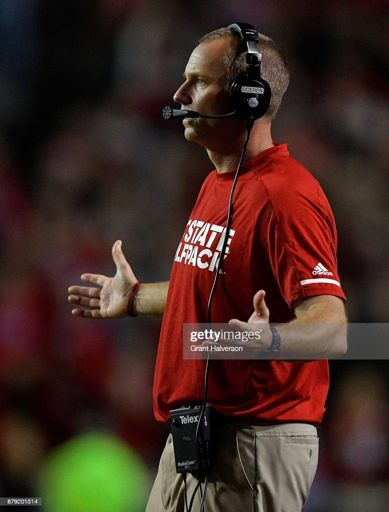Head coach Dave Doeren of the North Carolina State Wolfpack reacts during their win against the North Carolina Tar Heels at Carter Finley Stadium on November 25, 2017 in Raleigh, North Carolina. North Carolina State won 33-21.
