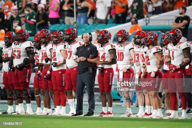 Head Coach Dave Doeren of the North Carolina State Wolfpack stands with the team during the National Anthem prior to the game against the Miami...