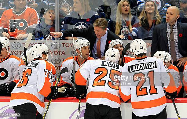 Head Coach Dave Hakstol of the Philadelphia Flyers gives directions to his players during a first period stoppage against the Winnipeg Jets at the...
