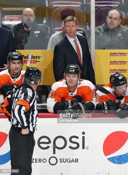 Head Coach Dave Hakstol of the Philadelphia Flyers looks toward Referee Kyle Rehman behind Valtteri Filppula Jori Lehtera and Jordan Weal against the...