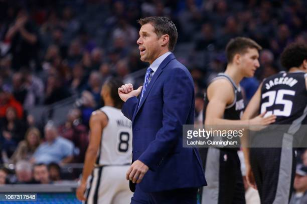Head coach Dave Joerger of the Sacramento Kings talks to a referee during a timeout from the game against the San Antonio Spurs at Golden 1 Center on...