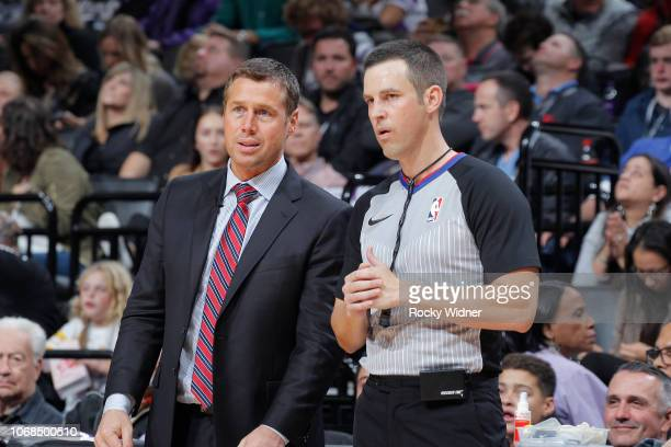 Head coach Dave Joerger of the Sacramento Kings talks with NBA referee Kevin Scott during the game against the Los Angeles Clippers on November 29...