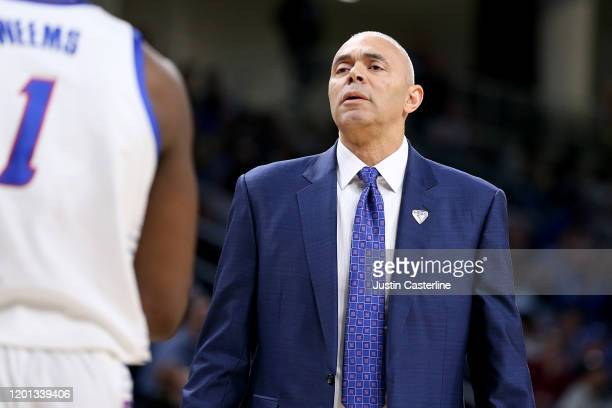 Head coach Dave Leitao of the DePaul Blue Demons talks to his team during a time out in the game against the Creighton Bluejays during the first half...