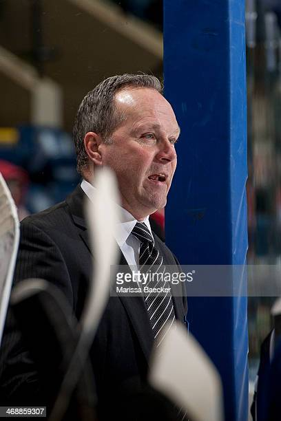 Head coach Dave Lowry of the Victoria Royals stands on the bench against the Kelowna Rocketson February 8 2014 at Prospera Place in Kelowna British...