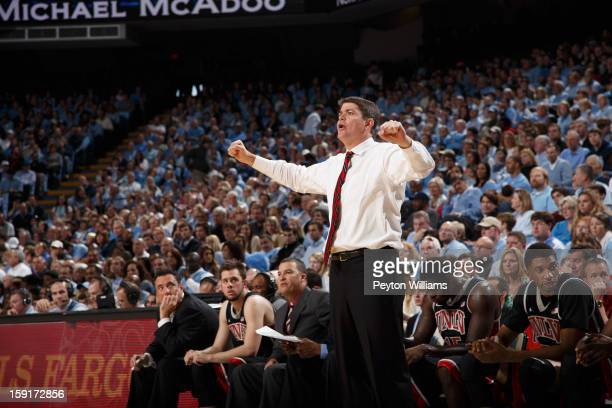 Head coach Dave Rice of the UNLV Rebels coaches during a game against the North Carolina Tar Heels on December 29 2012 at the Dean E Smith Center in...