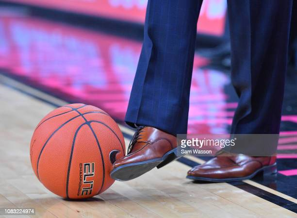 Head coach Dave Rose of the Brigham Young Cougars stops a loose ball with his foot during his team's game against the UNLV Rebels at TMobile Arena on...