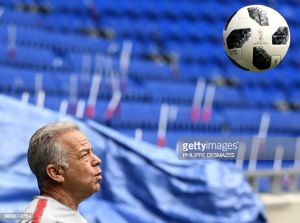 Head coach Dave Sarachan eyes the ball during a training session of the US national football team, on June 8 at the Groupama Stadium in...
