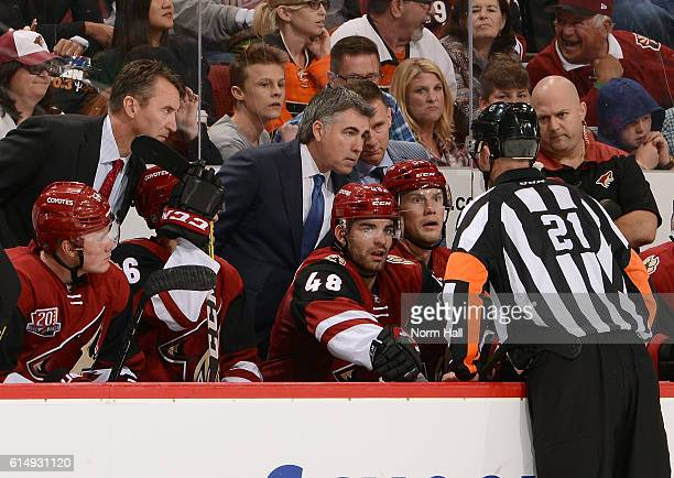 Head coach Dave Tippett of the Arizona Coyotes listens as referee TJ Luxmore explains a noncall against the Philadelphia Flyers during the third...
