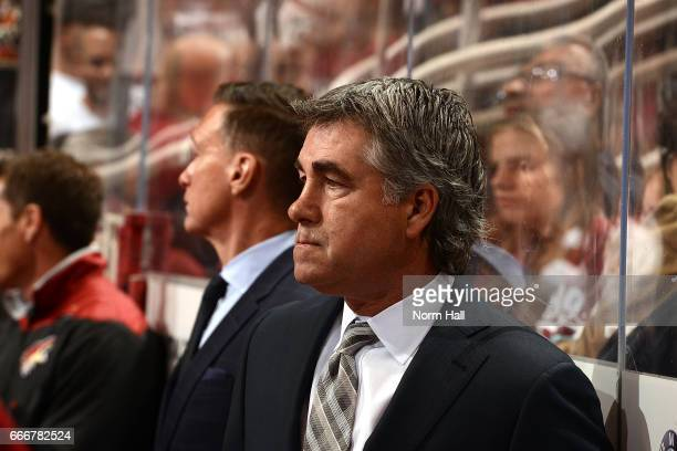 Head coach Dave Tippett of the Arizona Coyotes looks on from the bench during a game against the Minnesota Wild at Gila River Arena on April 8 2017...