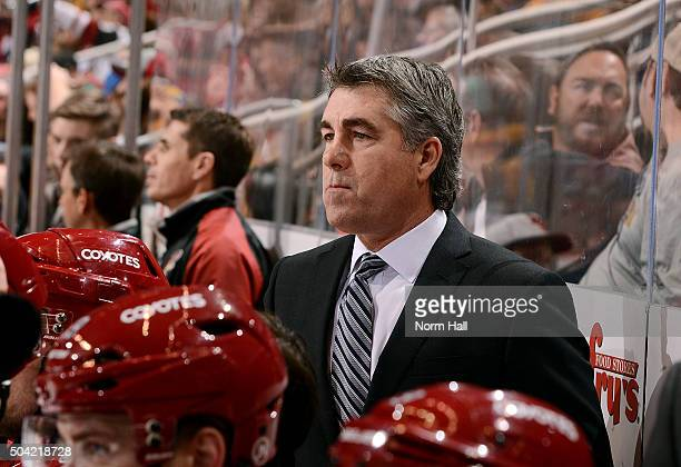 Head coach Dave Tippett of the Arizona Coyotes looks on from the bench during third period action against the Nashville Predators at Gila River Arena...
