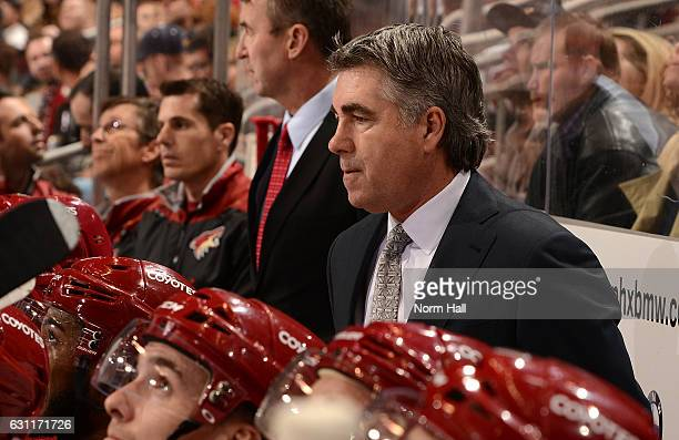 Head coach Dave Tippett of the Arizona Coyotes looks on from the bench during the first period against the New York Islanders at Gila River Arena on...
