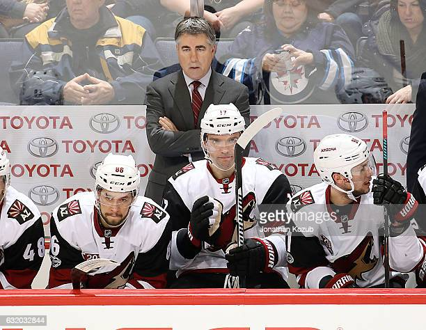 Head Coach Dave Tippett of the Arizona Coyotes looks on from the bench during third period action against the Winnipeg Jets at the MTS Centre on...