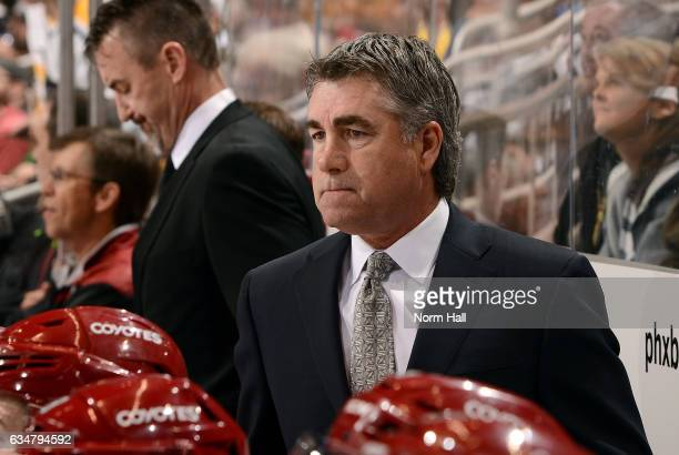 Head coach Dave Tippett of the Arizona Coyotes looks on from the bench during first period action against the Pittsburgh Penguins at Gila River Arena...