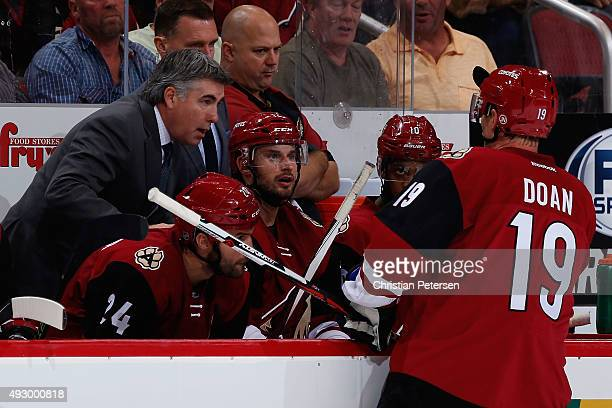 Head coach Dave Tippett of the Arizona Coyotes talks with Shane Doan during the NHL game against the Minnesota Wild at Gila River Arena on October 15...