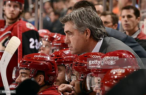 Head coach Dave Tippett of the Arizona Coyotes watches first period action against the Edmonton Oilers at Gila River Arena on December 21 2016 in...