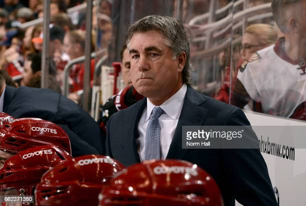 Head coach Dave Tippett of the Arizona Coyotes watches first period action against the Washington Capitals at Gila River Arena on March 31 2017 in...