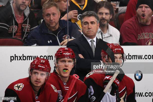 Head coach Dave Tippett of the Arizona Coyotes watches from the bench during the third period of the NHL game against the Pittsburgh Penguins at Gila...
