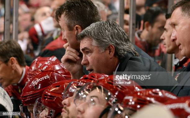 Head coach Dave Tippett of the Arizona Coyotes watches third period action against the Vancouver Canucks at Gila River Arena on April 6 2017 in...