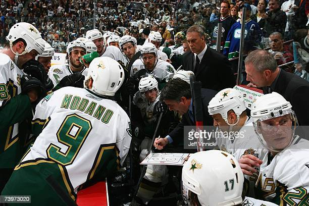 Head coach Dave Tippett of the Dallas Stars diagrams a play from the bench against the Vancouver Canucks during Game 7 of the 2007 Western Conference...