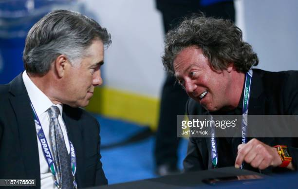 Head Coach Dave Tippett of the Edmonton Oilers talks with owner Daryl Katz during the first round of the 2019 NHL Draft at Rogers Arena on June 21...