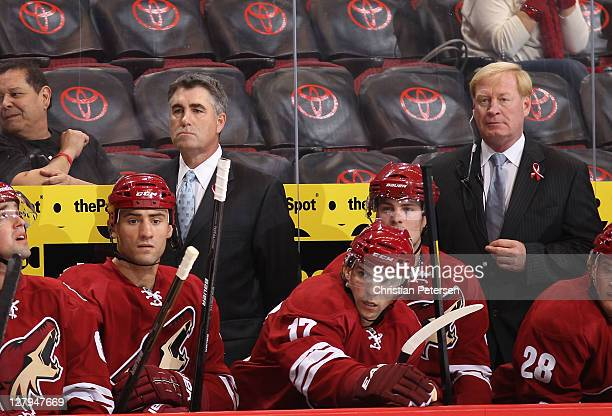 Head coach Dave Tippett of the Phoenix Coyotes watches from the bench during the preseason NHL game against the San Jose Sharks at Jobingcom Arena on...