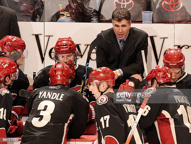 Head Coach Dave Tippett talks to his team during a time out against the Dallas Stars on November 27 2009 at Jobingcom Arena in Glendale Arizona