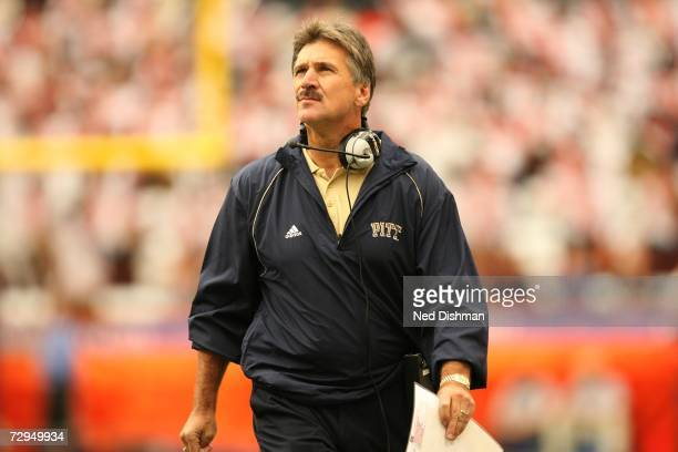 Head coach Dave Wannstedt of the University of Pittsburgh Panthers walks on the sideline against the Syracuse University Orange at the Carrier Dome...