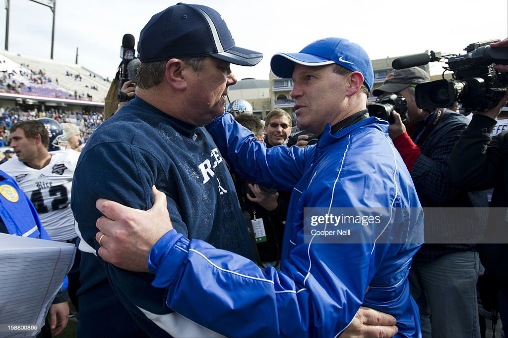 Head Coach David Bailiff of the Rice Owls (left) and Head coach Troy Calhoun of the Air Force Falcons exchange words after the Bell Helicopter Armed Forces Bowl on December 29, 2012 at Amon G. Carter Stadium in Fort Worth, Texas.