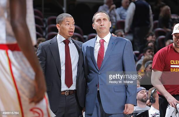 Head coach David Blatt and associate head coach Tyronn Lue of the Cleveland Cavaliers look on during the game against the Atlanta Hawks on November...