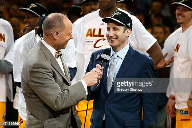 Head coach David Blatt of the Cleveland Cavaliers is interviewed by TV personality Ernie Johnson after defeating the Atlanta Hawks during Game Four...