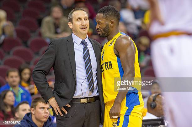 Head coach David Blatt of the Cleveland Cavaliers talks with Jeremy Pargo of Maccabi Tel Aviv during the second half at Quicken Loans Arena on...