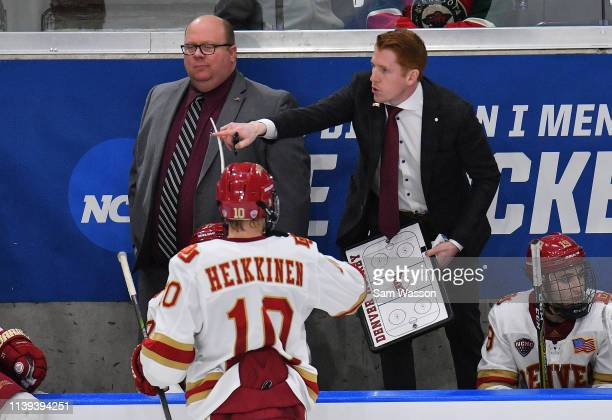 Head coach David Carle of the Denver Pioneers gives instructions to Jaakko Heikkinen during the NCAA Division I Men's Ice Hockey West Regional...