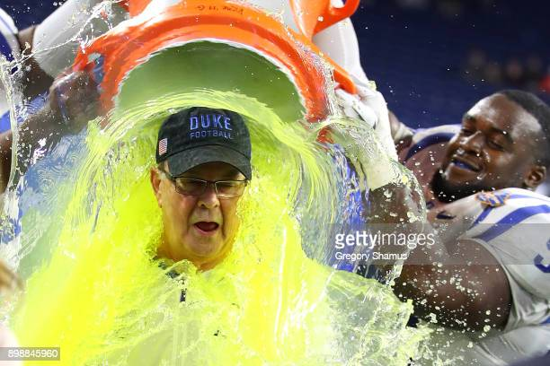 Head coach David Cutcliffe of the Duke Blue Devils reacts to his Gatorade bath by Mike Ramsay and Trevon McSwain after defeating the Northern...