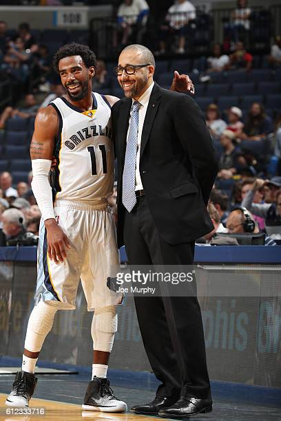 Head coach David Fizdale of the Memphis Grizzlies shakes hands with Mike Conley of the Memphis Grizzlies during the game against the Orlando Magic...