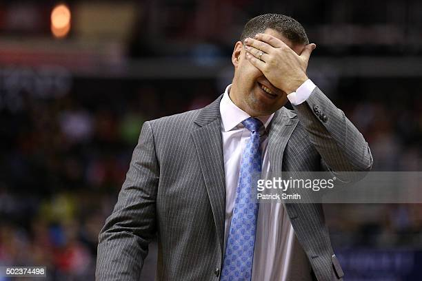 Head coach David Joerger of the Memphis Grizzlies reacts to a call against the Washington Wizards in the second half at Verizon Center on December 23...